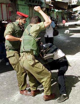 http://australiansforpalestine.com/wp-content/uploads/2010/01/IDF-beating-palestinian.jpg