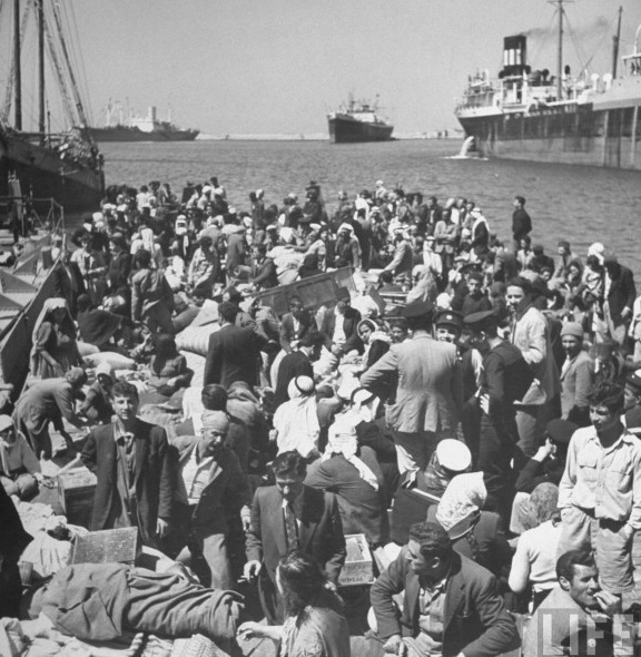 Palestinian refugees in Haifa waiting to be ferried out of the city