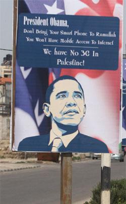 obama-west-bank-visit-placard-road-sign